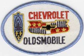 CHEVROLET-OLDSMOBILE TYGMÄRKE 107x68mm
