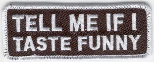 TELL ME IF I TASTE FUNNY TYGMÄRKE 100x38mm