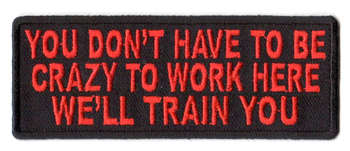 You Don't Have To Be Crazy To Work Here We'll Train You Tygmärke 101x38mm