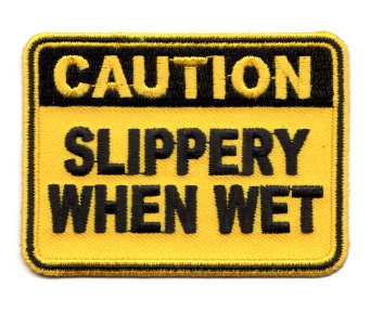 CAUTION SLIPPERY WHEN WET TYGMÄRKE